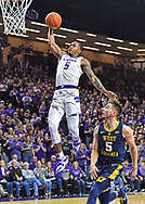 MANHATTAN, KS - JANUARY 09:  Barry Brown Jr. #5 of the Kansas State Wildcats scores on a brake away dunk against Jordan McCabe #5 of the West Virginia Mountaineers during the second half on January 9, 2019 at Bramlage Coliseum in Manhattan, Kansas.  (Photo by Peter G. Aiken/Getty Images) *** Local Caption *** Barry Brown Jr.;Jordan McCabe