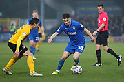 AFC Wimbledon midfielder Callum Reilly (33) dribbling during the EFL Sky Bet League 1 match between AFC Wimbledon and Southend United at the Cherry Red Records Stadium, Kingston, England on 1 January 2020.