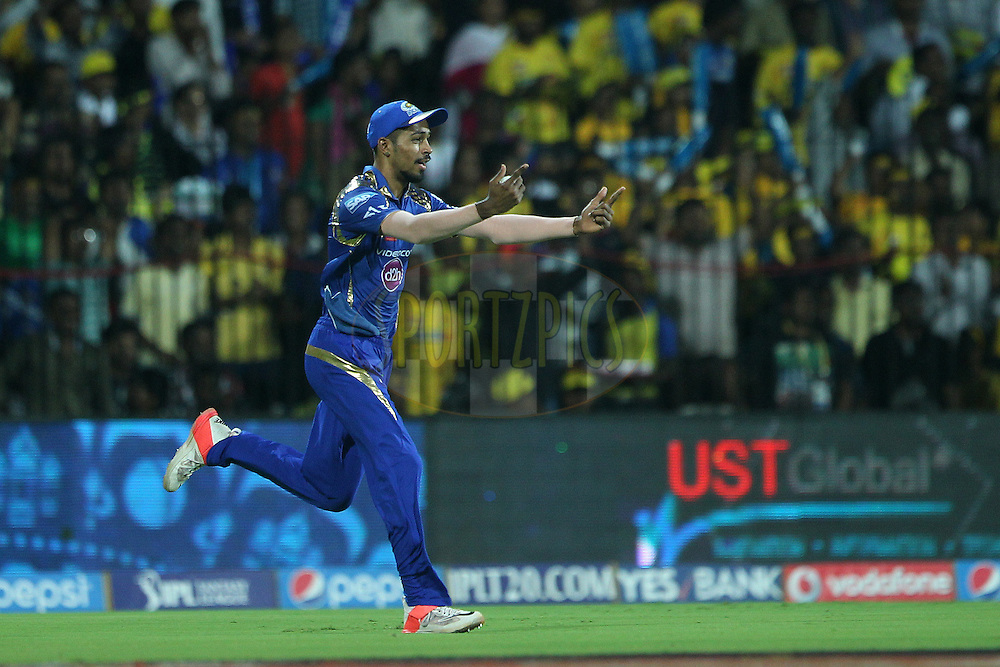 celebrates the wicket of Brendon McCullum of the Chennai Superkings  during match 43 of the Pepsi IPL 2015 (Indian Premier League) between The Chennai Superkings and The Mumbai Indians held at the M. A. Chidambaram Stadium, Chennai Stadium in Chennai, India on the 8th May April 2015.<br /> <br /> Photo by:  Ron Gaunt / SPORTZPICS / IPL