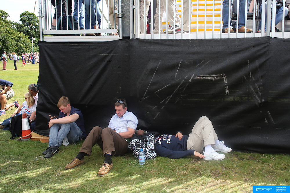 Spectators rest during the Cross Country event in the Eventing competition in front of massive crowds at Greenwich Park  during the London 2012 Olympic games. London. UK. 29th July 2012. Photo Tim Clayton