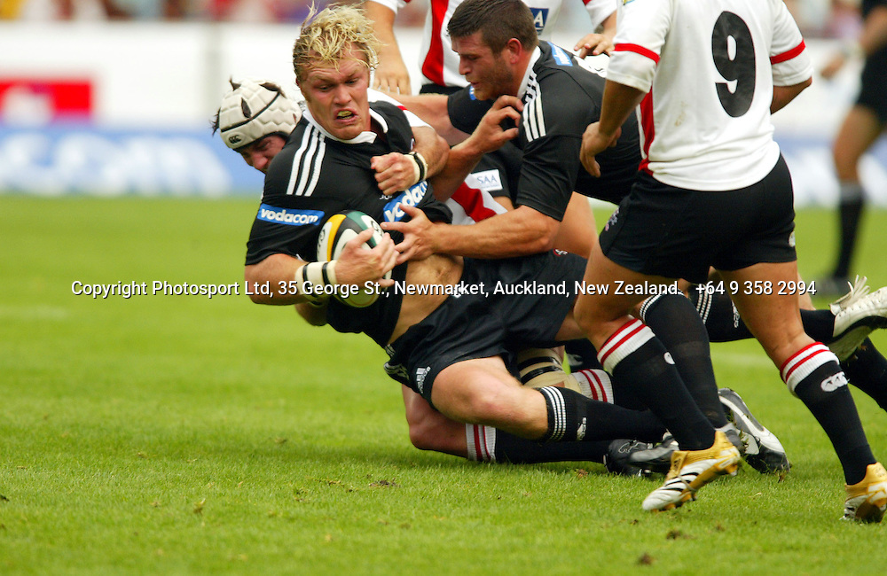 Schalk Burger gets tackles by Wikus van Heerden during the opening round of the 2006 Super 14 rugby union match between the Cats and the Stormers at Ellis Park, Johannesburg, South Africa on 11 February 2006. The Stormers won 23-12. Photo: Africa Visuals/PHOTOSPORT.  #NO AGENTS# NZ USE ONLY#