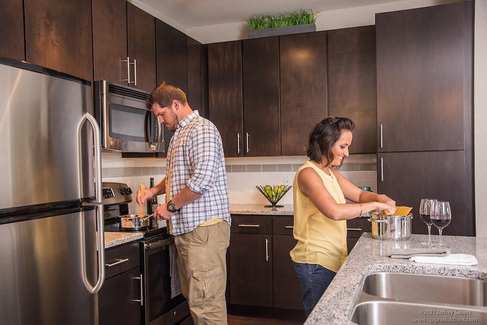 Lifestyle photo of couple cooking at Epic at Gateway Centre in St. Petersburg Florida by Jeffrey Sauers of Commercial Photographics, Architectural Photo Artistry in Washington DC, Virginia to Florida and PA to New England