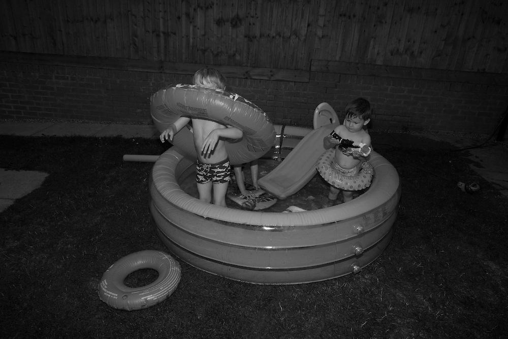 Boys play in the paddling pool in Berkhamsted, England  Saturday, Aug. 22, 2015 (Elizabeth Dalziel) #thesecretlifeofmothers #bringinguptheboys #dailylife