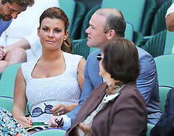 Wayne and Coleen Rooney  in the Royal Box for the Men's Final at the Wimbledon Tennis Championships in  London, Sunday, 7th July 2013<br /> Picture by Stephen Lock / i-Images