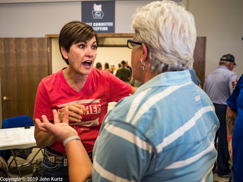 """15 JUNE 2019 - BOONE, IOWA: Governor KIM REYNOLDS (R-IA) talks to Iowa Republicans at """"Joni's Roast and Ride,"""" an annual fund raiser held by US Senator Joni Ernst (R-IA). Ernst, Iowa's junior US Senator, kicked off her re-election campaign during the """"Roast and Ride"""", an annual fund raiser and campaign event has she held since originally being elected to the US Senate in 2014.   PHOTO BY JACK KURTZ"""