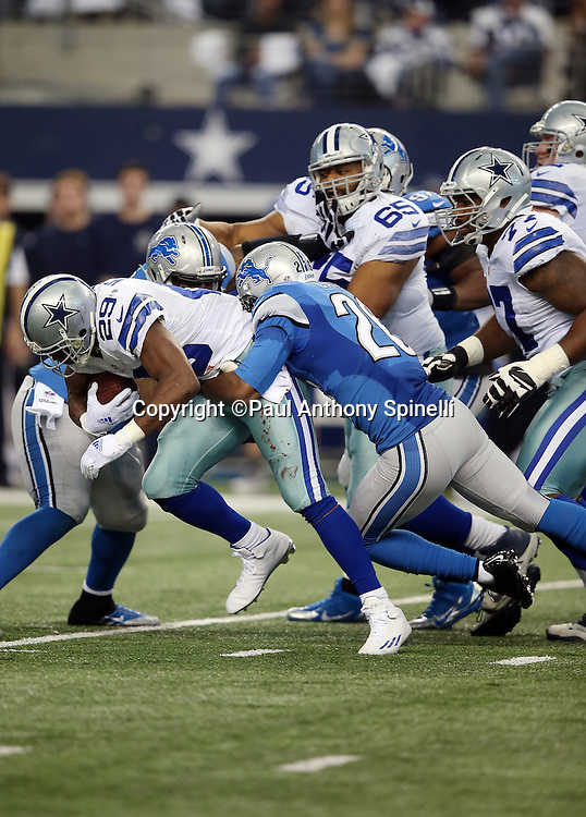 Dallas Cowboys running back DeMarco Murray (29) gets tackled by Detroit Lions strong safety Don Carey (26) on a first quarter run of 4 yards during the NFL week 18 NFC Wild Card postseason football game against the Detroit Lions on Sunday, Jan. 4, 2015 in Arlington, Texas. The Cowboys won the game 24-20. ©Paul Anthony Spinelli