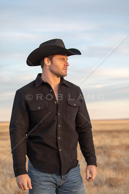 cowboy at sunset on a ranch