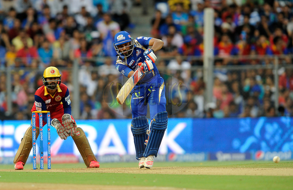 Rohit Sharma captain of Mumbai Indians bats during match 46 of the Pepsi IPL 2015 (Indian Premier League) between The Mumbai Indians and The Royal Challengers Bangalore held at the Wankhede Stadium in Mumbai, India on the 10th May 2015.<br /> <br /> Photo by:  Pal Pillai / SPORTZPICS / IPL