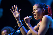 Rhiannon Giddens performing at the American Roots Music Festival in the Venetian Theater at Caramoor in Katonah New York on June 24, 2017. <br /> (photo by Gabe Palacio)