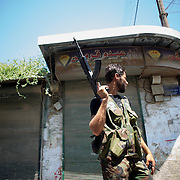 August 14, 2012 - Aleppo, Syria: A Free Syria Army (FSA) fighter takes guard at a rebel checkpoint in Babal Nassar neighborhood in Aleppo's old city. The Syrian Army have in the past ten days increased their attacks on residential neighborhoods where Free Syria Army rebel fights have their positions in Syria's commercial capital, Aleppo. (Paulo Nunes dos Santos/Polaris)