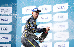 E.Dams Renault driver Sebastien Buemi celebrates with the trophy after winning the Visa London ePrix at Battersea Park, London.