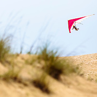 A hang glider makes final adjustments for the landing target during the world championships held at Jockey's Ridge State Park.  Nags Head, North Carolina