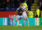 Luke Ayling of Leeds United holds up Burnley's Ashley Barnes during the EFL Cup match between Burnley and Leeds United at Turf Moor, Burnley, England on 19 September 2017. Photo by Paul Thompson.