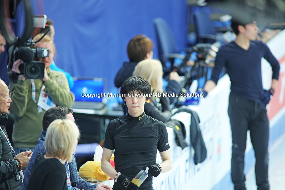 Helsinki, Finland - March 28<br />Figure Skater Yuzuru Hanyu,  from Japan, looks confused after a mixed practice session. He is speaking with coaches during morning practice session at the main rink of the Harwall Arena ahead of the Figure Skating World Championships. He had a mixed session with successful combinations and quads, but a number of failed jumps. (Photo by Myriam Cawston/MB Media Solutions)