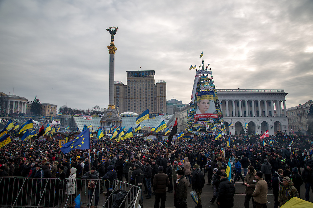 "The Independance Square was already full with protesters this morning, waving Urkainian and European flags and yelling ""Freedom for Ukraine""."