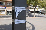 Ripped Catalonia Referendum Posters on Rambla del Cellar near the City Hall of Sant Cugat, Barcelona, Catalonia. The Spanish authorities have clamped down on the publishing of referendum materials by the Catalan independence movement, so ordinary people have started printing and distribution posters. Authorities and supporters of Spain have responded by removing the posters.
