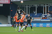 York City forward Vadaine Oliver climbs highest during the Sky Bet League 2 match between Luton Town and York City at Kenilworth Road, Luton, England on 10 October 2015. Photo by Simon Davies.