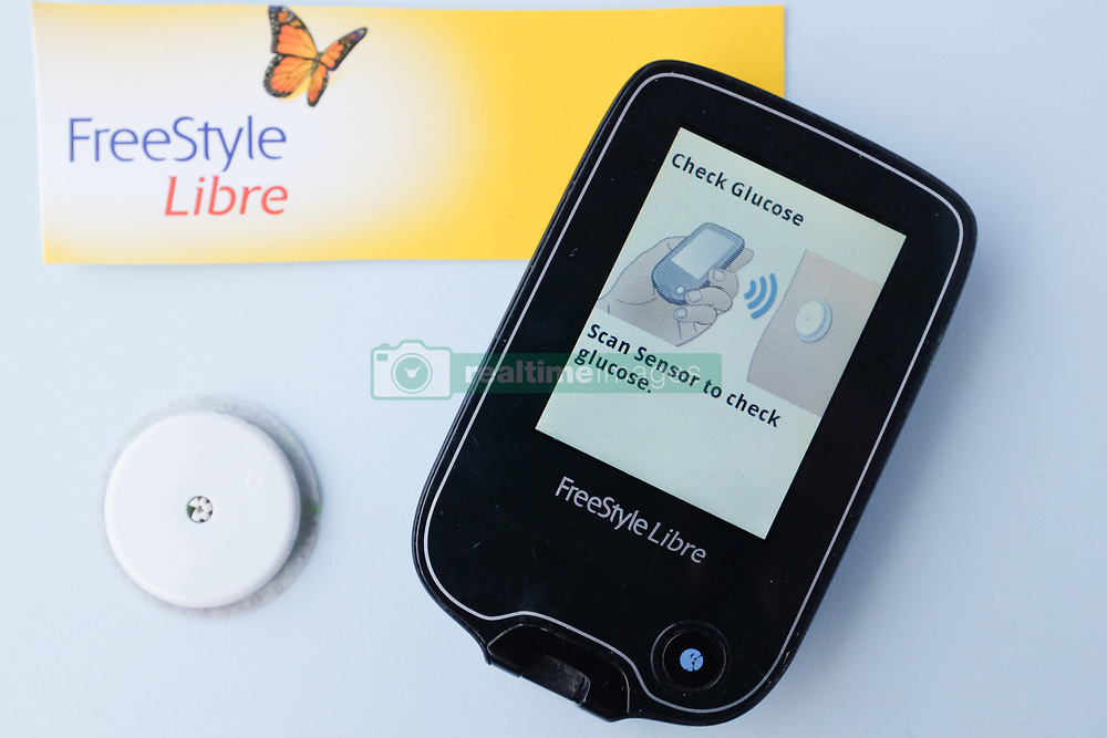 A FreeStyle Libre Flash Glucose sensor and reader. The device usually worn on the upper arm, helps people with Type 1 diabetes monitor their blood sugar levels. Each sensor last 14 days and costs around £50. The technology is available on the NHS in some areas (depending on local approval). Photo credit should read: Katie Collins/EMPICS