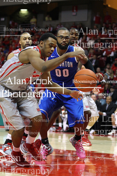 02 January 2013:  Zeke Upshaw grabs a bounding ball from in front of Gregory Echenique during an NCAA Missouri Vally Conference (MVC) mens basketball game between the Creighton University Bluejays and the Illinois State Redbirds in Redbird Arena, Normal IL