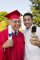 Graduate and Son Taking Picture with Camera Phone