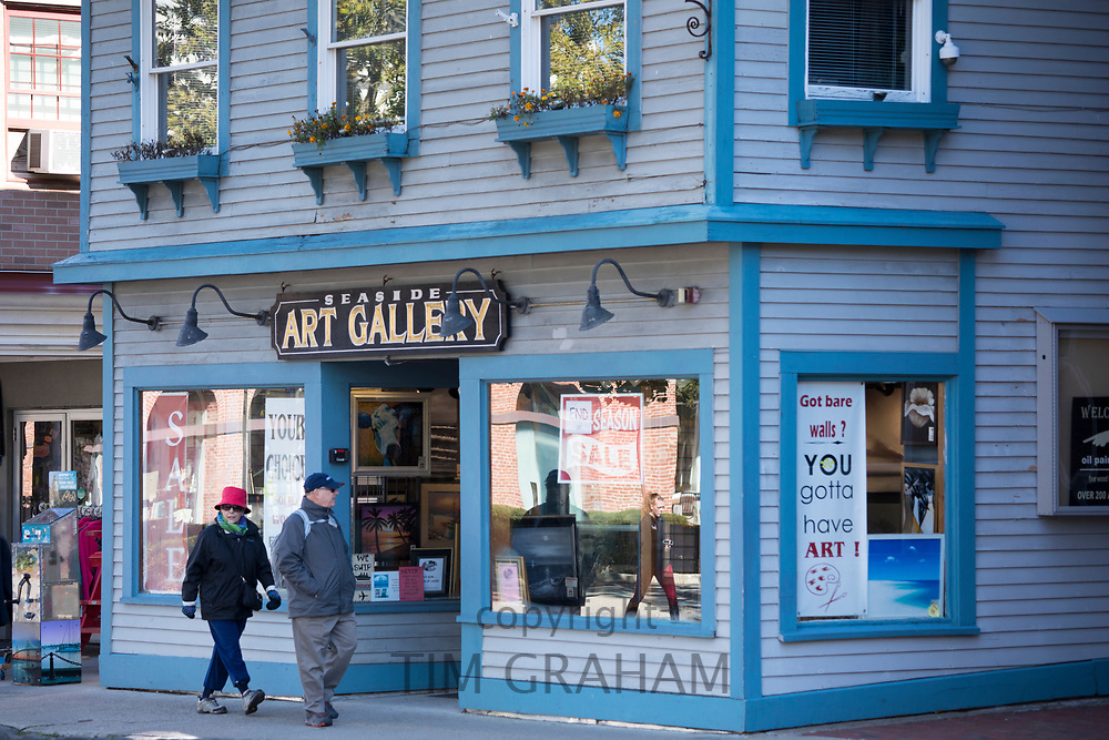 People strolling past wood clapboard Seaside Art Gallery in typical street scene in Newport, Rhode Island, USA