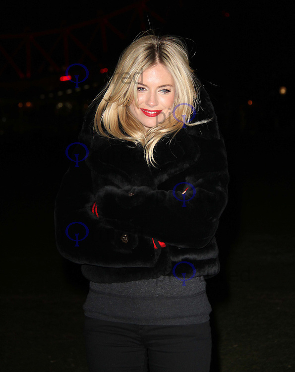 (RED) Supporter Sienna Miller Lights London Eye Red For World AIDS Day, Jubilee Gardens, Southbank, London UK, 01 December 2010: piQtured Sales: Ian@Piqtured.com +44(0)791 626 2580 (picture by Richard Goldschmidt)