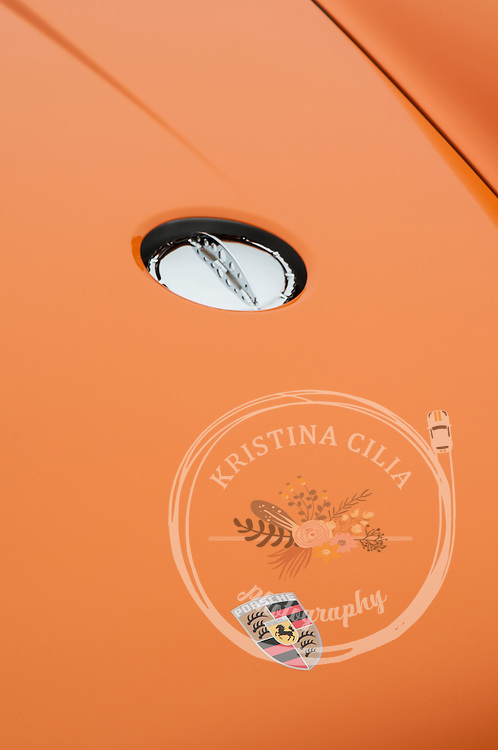 A modified M491 Porsche 911 Carrera in Signal Orange. Photo by Kristina Cilia