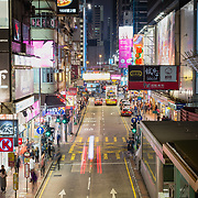 usy street at night in Kowloon, Hong Kong