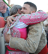 BEA AHBECK/NEWS-SENTINEL<br /> Grupo Forcados Amadores Luso-Americanos' captain Mike Lopes hugs retiring Mario Teixeira during the last grab (their third) during the bloodless bullfight during the Our Lady of Fatima Portuguese Festival in Thornton Saturday, Oct. 14, 2017.