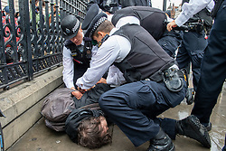 © Licensed to London News Pictures. 06/06/2020. London, UK. A man is wrestled to the ground and arrested. A Protest held in London in support of justice for George Floyd Jr. Floyd died during a police arrest in Minneapolis, Minnesota, USA on the 25th May 2020. Protests in response to Floyd's death, also with a broader focus on police violence against other black Americans, quickly spread across the United States and internationally. Photo credit: Peter Manning/LNP