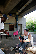 26 year old Bre talks with an unidentified man near downtown New Orleans on April 13, 2007. Bre has been living on and off the street for 10 years. She currently currently sleeps where she can, occasionally in an abandoned house behind the Economy Inn.  Like many people in New Orleans Bre has been unable to collect benefits because she lost her ID and birth certificate in the storm. The lack of ID and paperwork is one of the largest problems facing New Orleans low income residents because it dictates whether or not they can receive assistance.