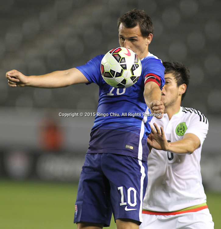United States' Luis Gil #10 actions against Mexico's Pedro Hern‡ndez #6 during a men's national team international friendly match, April 22, 2015, at StubHub Center in Carson, California. United States won 3-0.  (Photo by Ringo Chiu/PHOTOFORMULA.com)