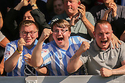 Coventry fans celebrate Coventry City forward Marcus Tudgay equaliser during the Sky Bet League 1 match between Burton Albion and Coventry City at the Pirelli Stadium, Burton upon Trent, England on 6 September 2015. Photo by Simon Davies.