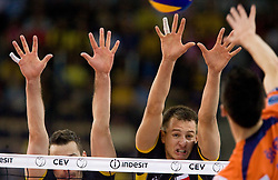 Daniel Plinski and Bartosz Kurek of Belchatow vs Alen Sket of ACH at  match for 3rd place of CEV Indesit Champions League FINAL FOUR tournament between PGE Skra Belchatow, POL and ACH Volley Bled, SLO on May 2, 2010, at Arena Atlas, Lodz, Poland. Belchatow defeated ACH 3-1. (Photo by Vid Ponikvar / Sportida)