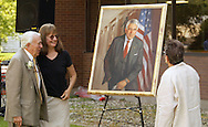 Ben Gilman, left, and his wife Georgia, far right, look a the portrait that was unveiled during the groundbreaking ceremony for SUNY Orange's planned Gilman Center for International Education on the college's Middletown campus on Aug. 2, 2007.