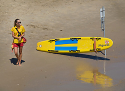 © Licensed to London News Pictures. 26/06/2018. Bournemouth, UK. A life guard patrols in hot afternoon sunshine on the beach at Bournemouth. Most of the UK is enjoying summer temperatures in the high 20's today. Photo credit: Peter Macdiarmid/LNP