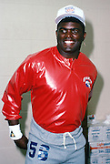 New York Giants linebacker Lawrence Taylor (56) smiles in the locker room after practice the week of the 1990 NFL Pro Bowl between the National Football Conference and the American Football Conference on Jan. 30, 1990 in Honolulu. The NFC won the game 27-21. (©Paul Anthony Spinelli)emotion,