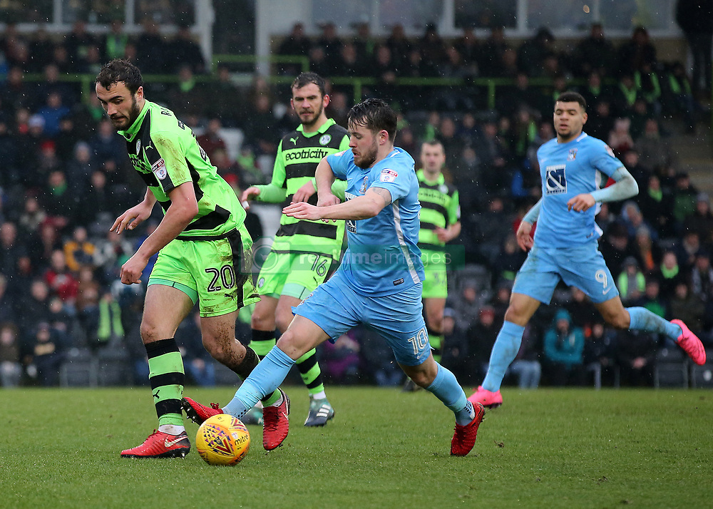 Coventry City's Marc McNulty takes the ball around Forest Green Rovers Farrend Rawson