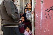 Residents of the newly liberated neighborhood of Aden peer outside of their homes as the Iraqi Army enters. Mosul, Iraq. Nov. 25, 2016. (Photo by Gabriel Romero ©2016)