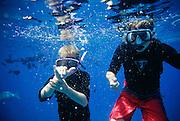 Shaka sign, boys snorkeling, Hawaii