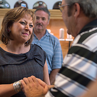 063015      Cayla Nimmo<br /> <br /> Governor Susana Martinez shakes the hand of Grants Martin Hicks and other attendees at her speech accommodating the city for the tourism efforts at the Mining Museum Tuesday.