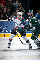 KELOWNA, CANADA - JANUARY 24: Brayden Low #11 of Everett Silvertips checks Rourke Chartier #14 of Kelowna Rockets on January 24, 2015 at Prospera Place in Kelowna, British Columbia, Canada.  (Photo by Marissa Baecker/Shoot the Breeze)  *** Local Caption *** Brayden Low; Rourke Chartier;