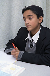 Boy in a lesson at the Nottingham Islamia school,
