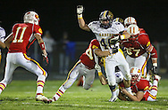 Central DeWitt's Christopher Keitel (48) tries pull away from Marion's Brandon Hornback (44) and Jordan Cole (43) during their second round playoff football game at Thomas Park Field in Marion on Monday, October 29, 2012.