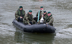 Oxford-Cambridge Boat race. Royal Marines bringing the trophy ashore at Putney, London, UK, 31 March, 2013. Photo by i-Images..