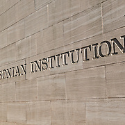 Smithsonian Institution sign etched into the stone exterior fo the National Air and Space Museum