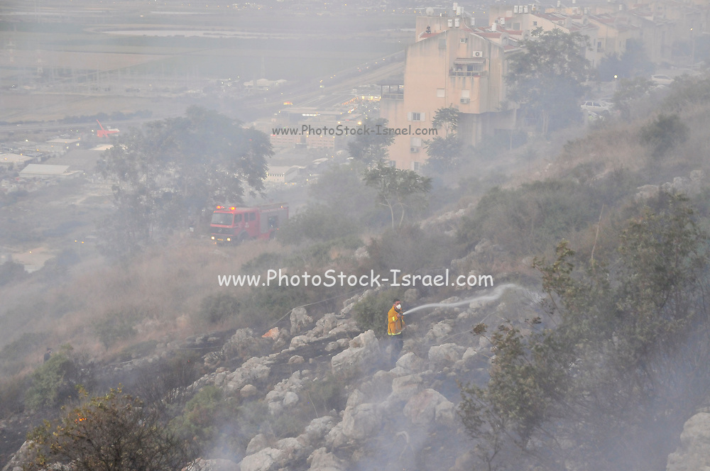 Wildfire on the Carmel Mountains, The city of Haifa, Israel can be seen in the background