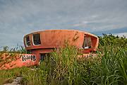 "The UFO House<br /> <br /> Located deep in Homestead, just a couple of miles from the Everglades entrance, is an odd-looking house. Locals call it the ""Alien House"" or ""UFO House"" simply because of the saucer-like shape the building has. Others claim a mob boss actually built the house, making it easy for any drug drops in the area. A dumber theory is that a nude colony lived there so they could live in solitude without having neighbors called out on them. Actual information on this place is pretty scarce though.<br /> <br /> According to property records, it was built in 1974, a time when architects were influenced by the space-age future such as the Futuro and Xanadu. Though it's two units with seperate bathrooms and even kitchens, it's counted as one home as it's connected by a walkway.<br /> <br /> <br /> <br /> Digging a bit deeper, I found a similar home in Plantation, Florida. Being built in 1977, it's still used and occupied to this day. The house in Homestead though is gutted, tagged, boarded up and had been condemned by the city.<br /> ©Abandoned Florida/Exclusivepix Media"