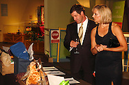 Bryan and Amy Moon of Trenton look at silent auction items during the 2013 Boonshoft Gala at the Boonshoft Museum of Discovery in Dayton.  The theme, Hip to be Square, is reflected in exhibits and demonstrations during the evening.