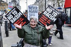 Anti-fascists demonstrating against Pegida (Patriotic Europeans against the Islamisation of the West) in Whitehall. Feb 2016 UK
